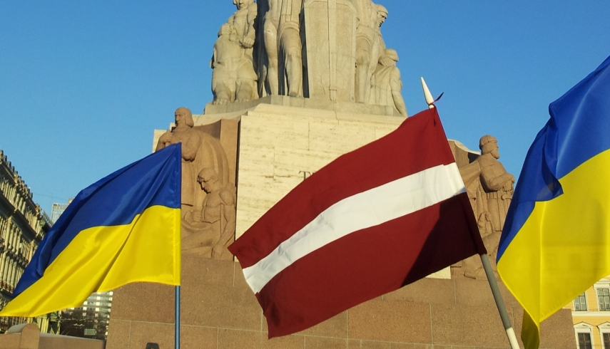 Ukrainian and Latvian flags fly at the Freedom Monument in Riga [Photo: Latvian History]