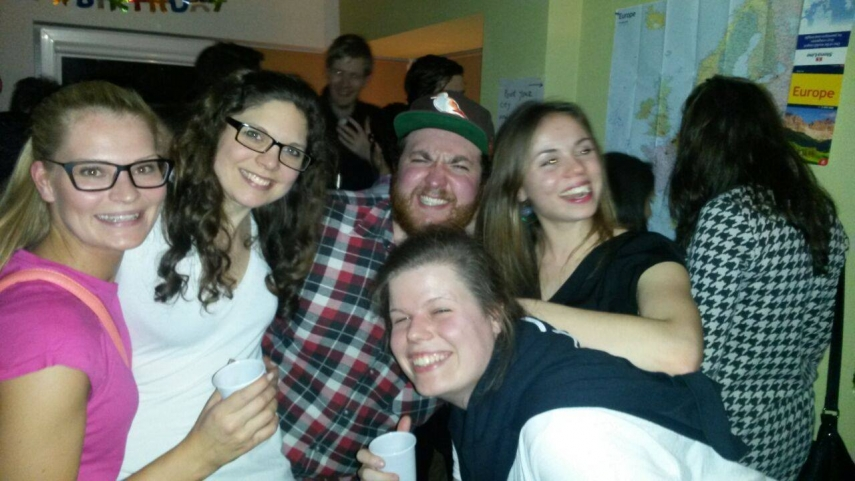 LAST SEEN: Stephan Engelbrecht, in the brown cap in the center of the photo, was last seen at this party in Riga.