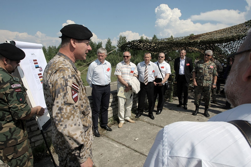 Latvian army colonel briefs visitors at the Adazi base [Image: Creative Commons]