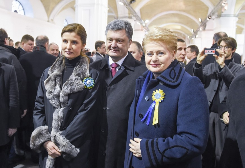 POSING WITH UKRAINE'S PROMOTER NUMBER 1: Ukraine's First Lady Maryna Poroshenko, Ukrainian President Petro Poroshenko and Lithuanian President Dalia Grybauskaite celebrating the first anniversary of the Ukrainian revolution in Kiev on Feb. 22. Photo courtesy of the Lithuanian president's site www.lrp.lt / Photo by Robertas Dackus