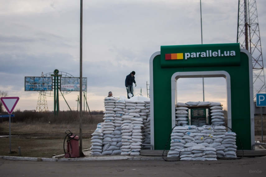 Sandbags shield a pump at a petrol station in the buffer zone.