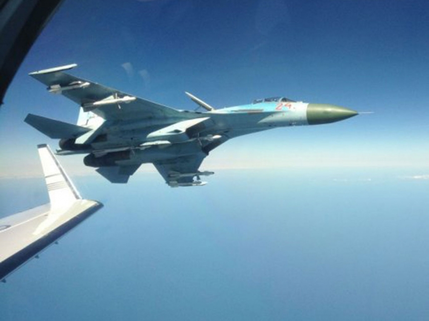 A Russian fighter jet under escort over the Baltic Sea [Image: independent.co.uk]