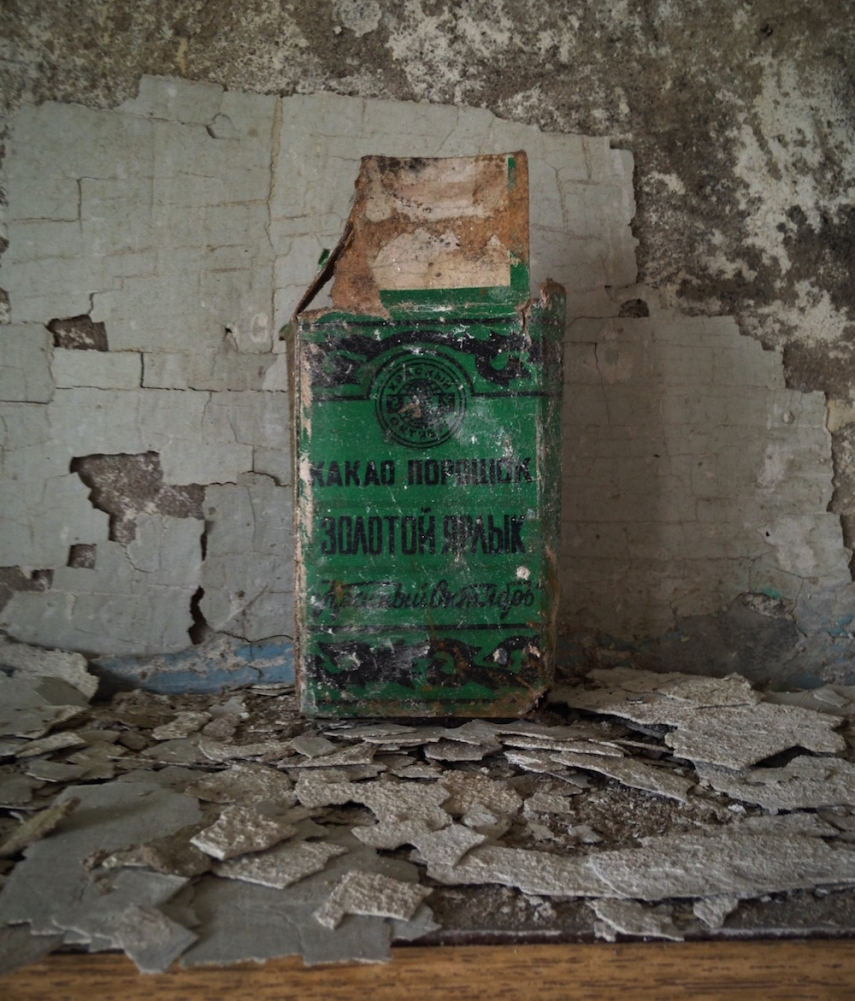 Apartment kitchen with the remains of a 'Golden Label Kakao' box, produced in Moscow's legendary Red October factory