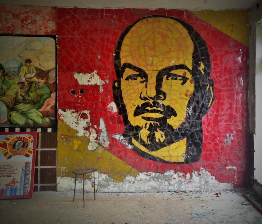 Lenin mural - unmarked despite extensive vandalism across the site - in the rear foyer of a school