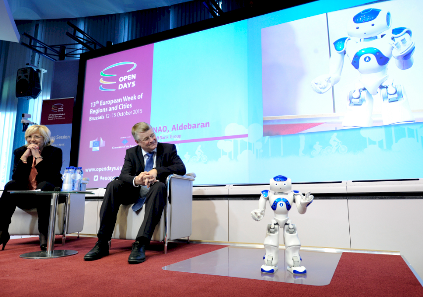 PERSONAL ASSISTANT: NAO, the humanoid, interactive, 'caring' robot, a product of the ERDF-funded project Juliette, entertains the audience during the OpenDays opening session.