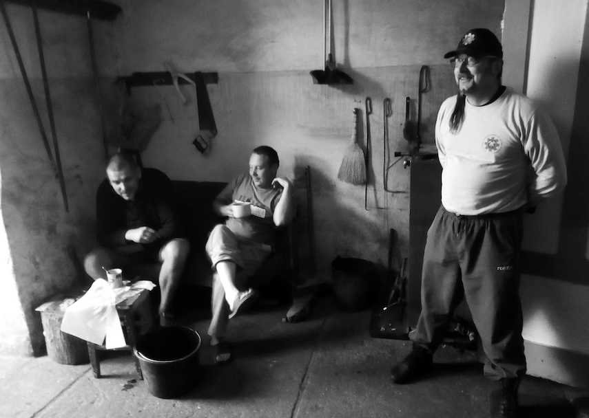 A fireman (right) and two friends in the former Kloyz in Žagarė, now the town's fire station.